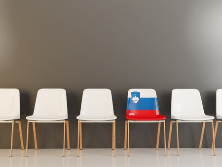 Chair with flag of slovenia in a row of white chairs. 3D illustration