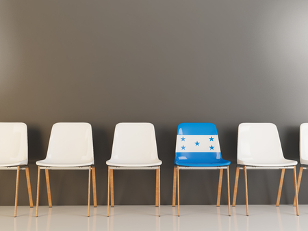 Chair with flag of honduras in a row of white chairs. 3D illustration