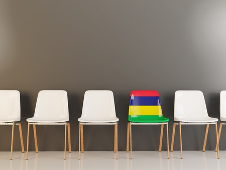 Chair with flag of mauritius in a row of white chairs. 3D illustration Stock Photo