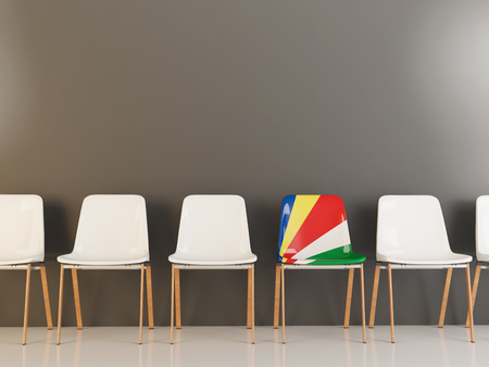 Chair with flag of seychelles in a row of white chairs. 3D illustration