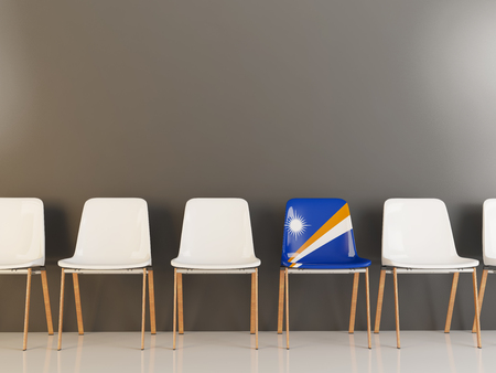 Chair with flag of marshall islands in a row of white chairs. 3D illustration 写真素材