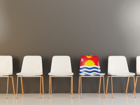 Chair with flag of kiribati in a row of white chairs. 3D illustration
