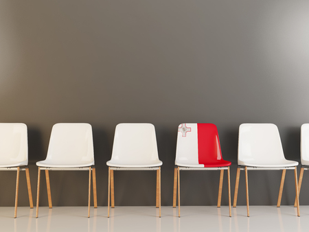 Chair with flag of malta in a row of white chairs. 3D illustration