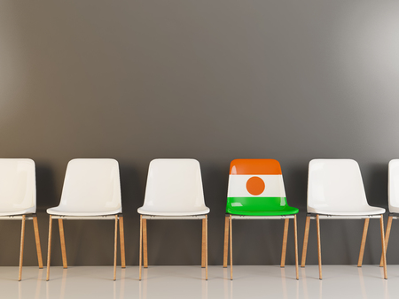 Chair with flag of niger in a row of white chairs. 3D illustration