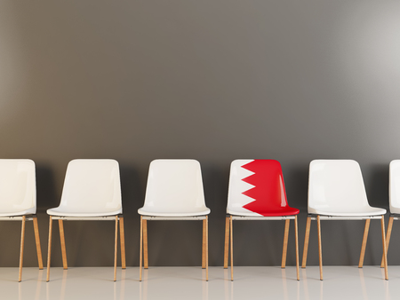 Chair with flag of bahrain in a row of white chairs. 3D illustration
