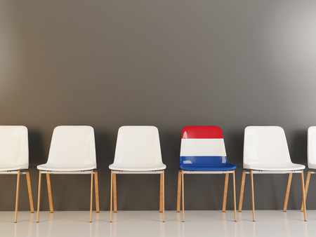 Chair with flag of netherlands in a row of white chairs. 3D illustration