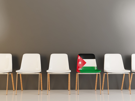Chair with flag of jordan in a row of white chairs. 3D illustration