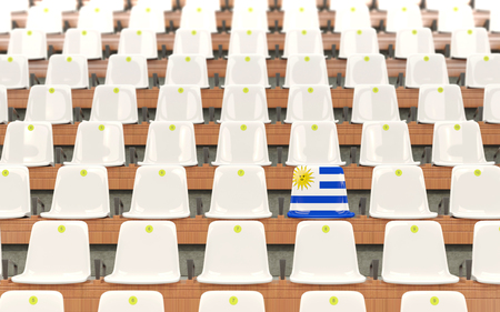 Stadium seat with flag of uruguay in a row of white chairs. 3D illustration Stock Photo