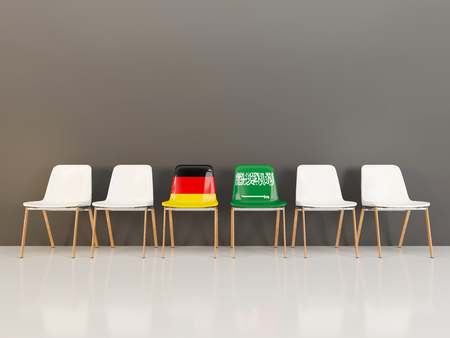 Chairs with flag of Germany and saudi arabia in a row. 3D illustration