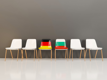 Chairs with flag of Germany and bulgaria in a row. 3D illustration