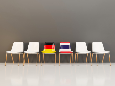 Chairs with flag of Germany and thailand in a row. 3D illustration Reklamní fotografie