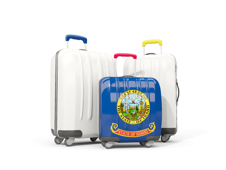 Luggage with flag of idaho. Three bags with united states local flags. 3D illustration