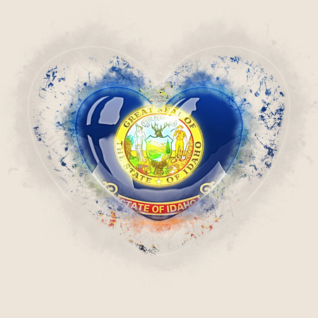 idaho state flag on a grunge heart. United states local flags. 3D illustration 写真素材