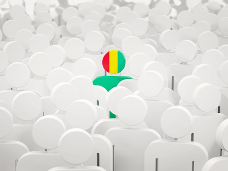 Man with flag of guinea in a crowd. 3D illustration 写真素材