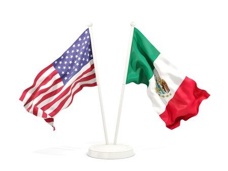 Deux drapeaux ondulant des États-Unis et du Mexique isolés sur blanc. illustration 3D