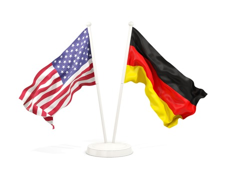 Two waving flags of United States and germany isolated on white. 3D illustration
