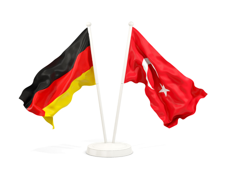 Two waving flags of Germany and turkey isolated on white. 3D illustration Stock Photo