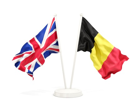 Two waving flags of UK and belgium isolated on white. 3D illustration Stock Photo
