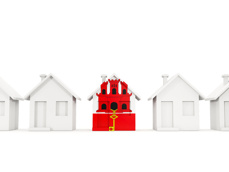 House with flag of gibraltar in a row of white houses. Real estate concept. 3D illustration