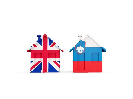 Two houses with flags of United Kingdom and slovenia isolated on white. Communication concept. 3D illustration