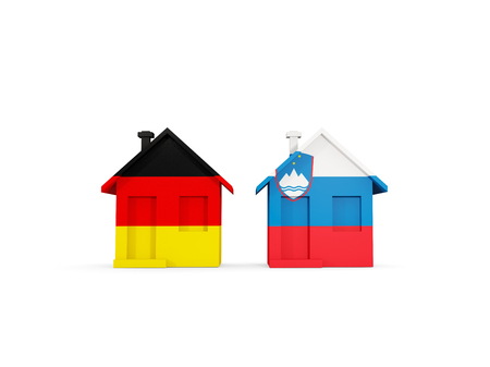 Two houses with flags of Germany and slovenia isolated on white. Communication concept. 3D illustration 스톡 콘텐츠