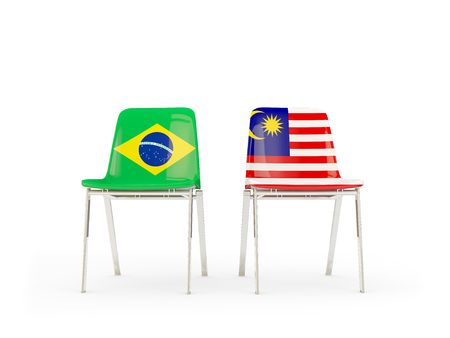 Two chairs with flags of Brazil and malaysia isolated on white. Communicationdialog concept. 3D illustration