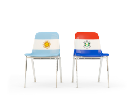 Two chairs with flags of Argentina and paraguay isolated on white. Communication/dialog concept. 3D illustration