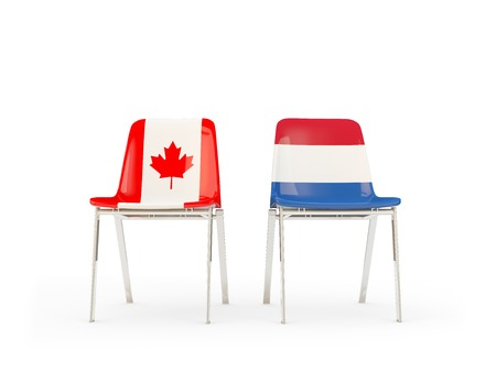 Two chairs with flags of Canada and netherlands isolated on white. Communicationdialog concept. 3D illustration