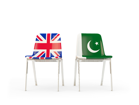 Two chairs with flags of United Kingdom and pakistan isolated on white. Communicationdialog concept. 3D illustration