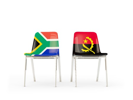 Two chairs with flags of South Africa and angola isolated on white. Communicationdialog concept. 3D illustration
