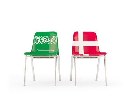 Two chairs with flags of Saudi Arabia and denmark isolated on white. Communicationdialog concept. 3D illustration 版權商用圖片