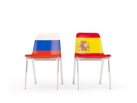 Two chairs with flags of Russia and spain isolated on white. Communicationdialog concept. 3D illustration 版權商用圖片