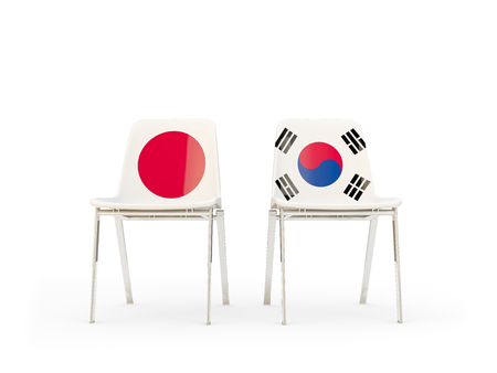 Two chairs with flags of Japan and south korea isolated on white. Communicationdialog concept. 3D illustration