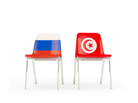 Two chairs with flags of Russia and tunisia isolated on white. Communicationdialog concept. 3D illustration