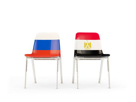 Two chairs with flags of Russia and egypt isolated on white. Communicationdialog concept. 3D illustration 版權商用圖片