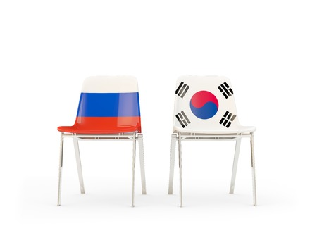 Two chairs with flags of Russia and south korea isolated on white. Communicationdialog concept. 3D illustration