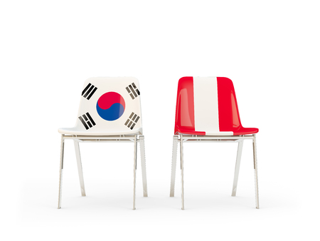 Two chairs with flags of South Korea and peru isolated on white. Communicationdialog concept. 3D illustration 版權商用圖片