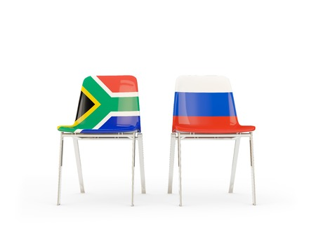 Two chairs with flags of South Africa and russia isolated on white. Communicationdialog concept. 3D illustration 版權商用圖片