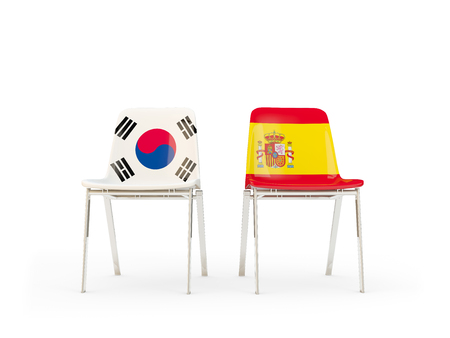 Two chairs with flags of South Korea and spain isolated on white. Communicationdialog concept. 3D illustration