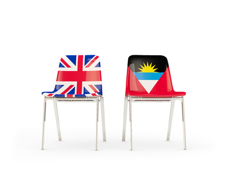 Two chairs with flags of United Kingdom and antigua and barbuda isolated on white. Communicationdialog concept. 3D illustration