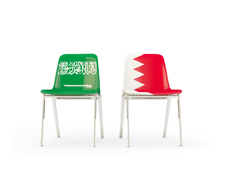 Two chairs with flags of Saudi Arabia and bahrain isolated on white. Communicationdialog concept. 3D illustration 版權商用圖片