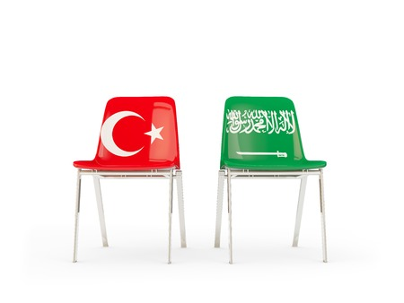 Two chairs with flags of Turkey and saudi arabia isolated on white. Communicationdialog concept. 3D illustration 版權商用圖片