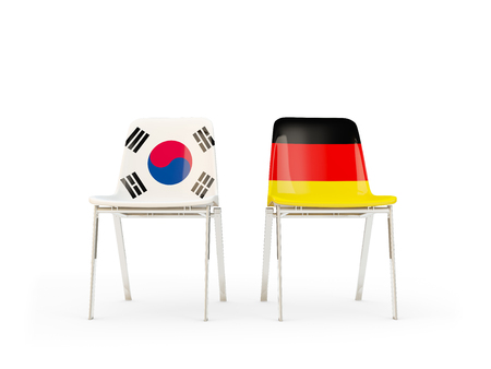 Two chairs with flags of South Korea and germany isolated on white. Communicationdialog concept. 3D illustration