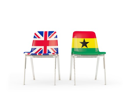 Two chairs with flags of United Kingdom and ghana isolated on white. Communicationdialog concept. 3D illustration