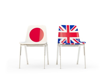 Two chairs with flags of Japan and UK isolated on white. Communicationdialog concept. 3D illustration