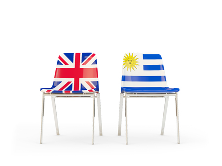 Two chairs with flags of United Kingdom and uruguay isolated on white. Communicationdialog concept. 3D illustration