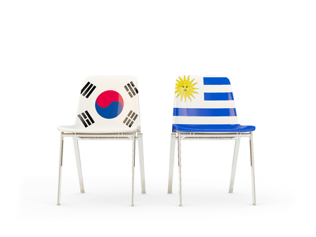 Two chairs with flags of South Korea and uruguay isolated on white. Communicationdialog concept. 3D illustration