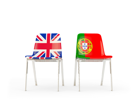 Two chairs with flags of United Kingdom and portugal isolated on white. Communicationdialog concept. 3D illustration 版權商用圖片