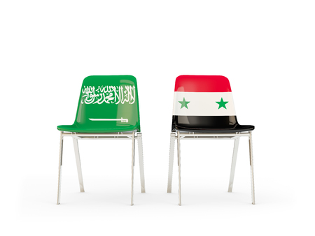 Two chairs with flags of Saudi Arabia and syria isolated on white. Communicationdialog concept. 3D illustration 版權商用圖片