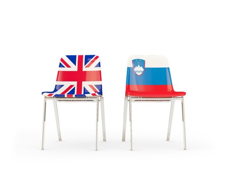 Two chairs with flags of United Kingdom and slovenia isolated on white. Communicationdialog concept. 3D illustration